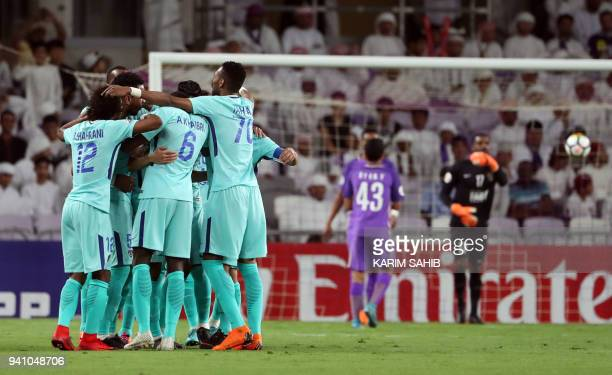 AlHilal players celebrate scoring against alAin during the AFC Champions League football match between UAE's alAin and Saudi's alHilal at the Hazza...