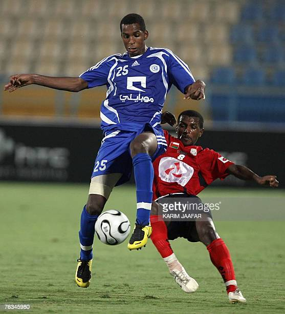 AlHilal Saudi club player Abdullah Mohammed vies with Adel Khalifa of the Omani Muscat club during their football match for the Gulf Council...
