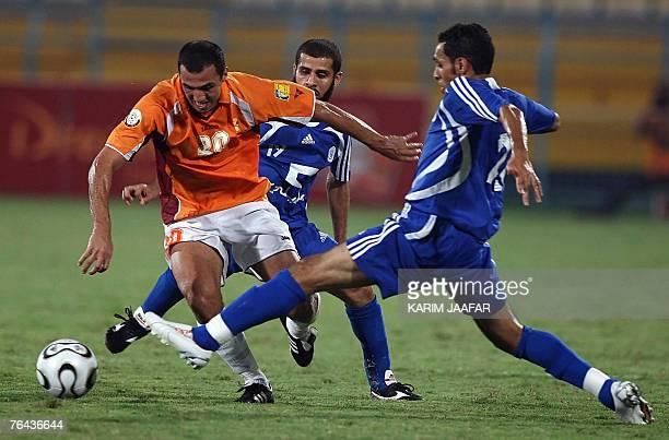 AlHilal Saudi club players Sultan alBarqan and Abdulaziz alKhathran fight for the ball with Jawad Hannach of Qatar's Umm Salal club during their Gulf...