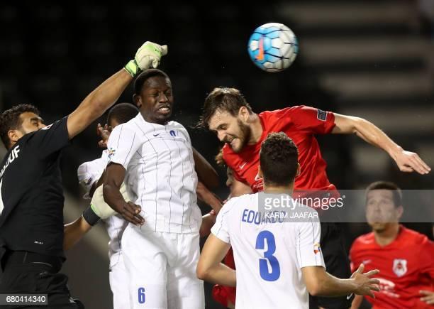 AlHilal's Abdulmalek Al Khaibri fights for the ball against alRayyan's Nathan Otávio during a AFC Champions League match between Qatar's alRayyan and...