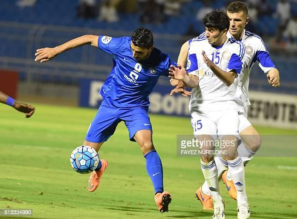 Al-Hilal's Ailton Almeida dribbles past Pakhtakor's Javokhir Sokhibov during their Asian Champions League football match at Prince Faisal Bin Fahd...