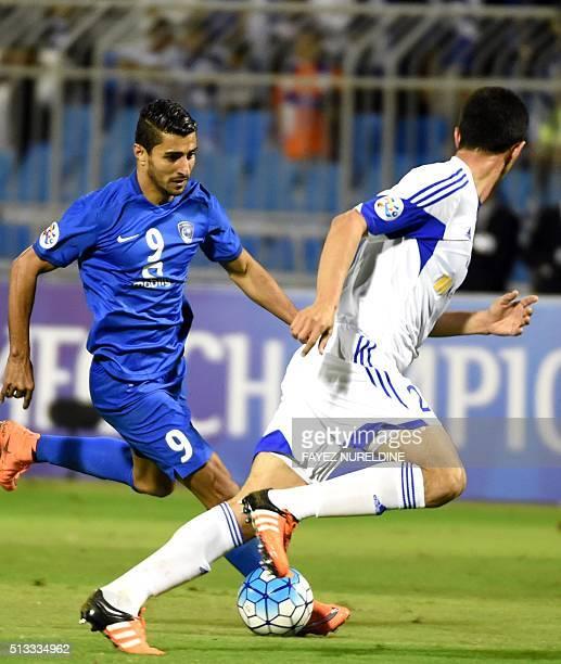 Al-Hilal's Ailton Almeida dribbles past Pakhtakor's Kamoliddin Tajiev during their Asian Champions League football match at Prince Faisal Bin Fahd...