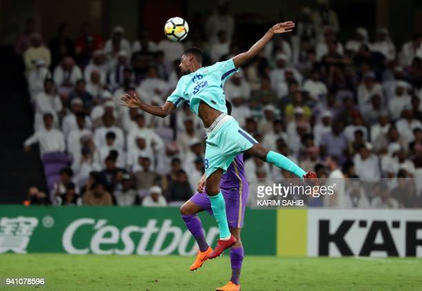 AlHilal's defender Mohamed Kanno clears the ball during the AFC Champions League football match between UAE's alAin and Saudi's alHilal at the Hazza...