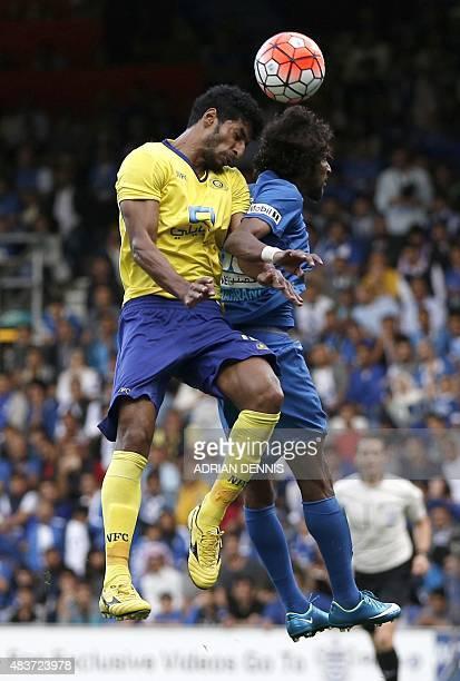 Al-Hilal's defender Yasser Al-Shahrani jumps for a header with Al-Nassr's midfielder Abdulaziz Al-Jebreen during the Saudi Super Cup between Al-Nassr...