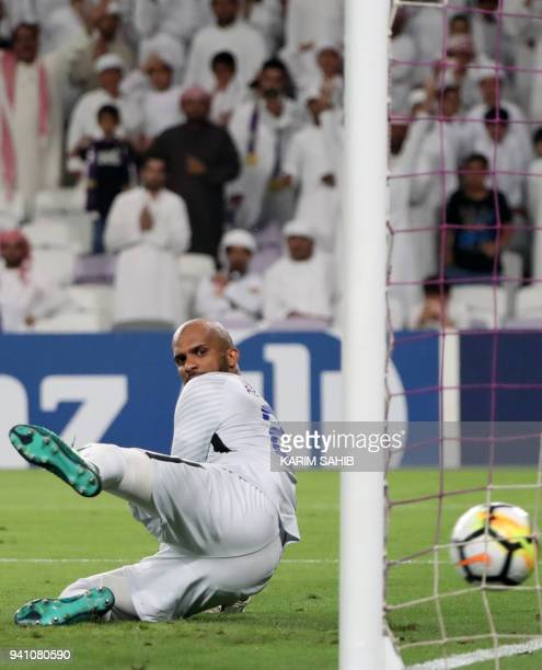 AlHilal's goalkeeper Ali AlHabsi watches as the ball ends up in the back of his net during the AFC Champions League football match between UAE's...