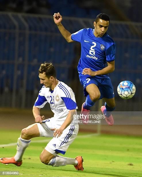 Al-Hilal's Mohammed Al-Breik dribbles past Pakhtakor's Stanislav Andreev during their Asian Champions League football match at Prince Faisal Bin Fahd...