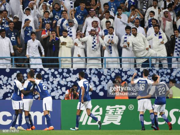 AlHilal's players celebrate during the AFC Champions League football match between Saudi alHilal and Qatari alRayyan at the King Saudi University...