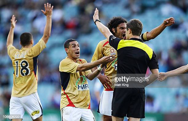 Ali Abbas and Nikolai ToporStanley of the Jets argue with referee Chris Beath after the goal to Bruno Cazarine of Sydney during the round 13 ALeague...