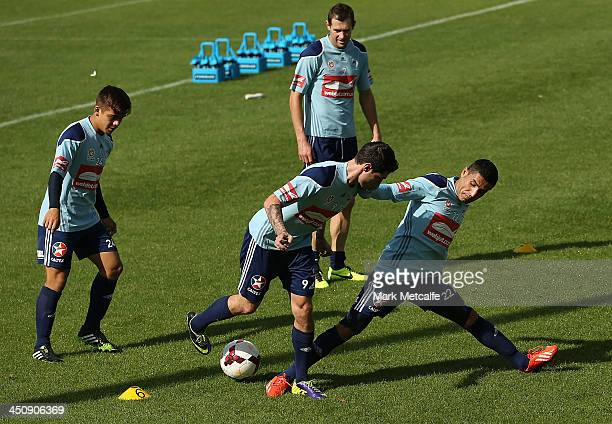 Ali Abbas challenges for the ball during a Sydney FC ALeague training session at Macquarie Uni on November 21 2013 in Sydney Australia