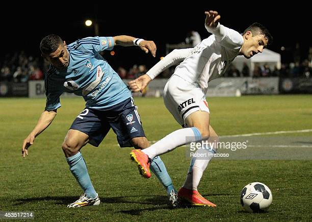 Ali Abbas of Sydney and Jason Hoffman of Melbourne City contest the ball during the FFA Cup match between Melbourne City and Sydney FC at Morshead...