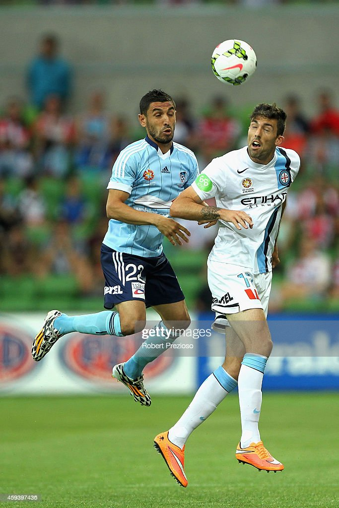 Ali Abbas of Sydney and Jason Hoffman of Melbourne contest the ball during the round seven A-League match between Melbourne City and Sydney FC at AAMI Park on November 22, 2014 in Melbourne, Australia.