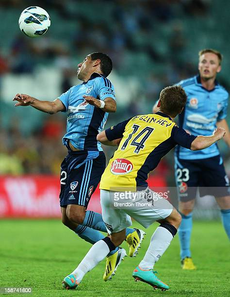 Ali Abbas of Sydney competes with Michael McGlinchey of the Mariners during the round 13 ALeague match between Sydney FC and the Central Coast...