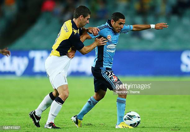 Ali Abbas of Sydney competes with Nick Montgomery of the Mariners during the round 13 ALeague match between Sydney FC and the Central Coast Mariners...