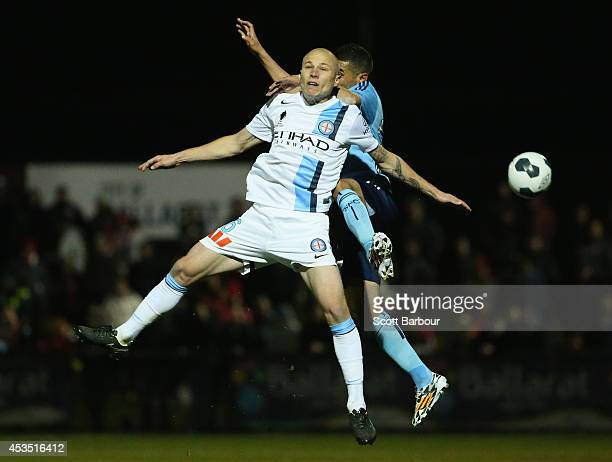 Ali Abbas of Sydney FC and Aaron Mooy of City compete for the ball during the FFA Cup match between Melbourne City and Sydney FC at Morshead Park...