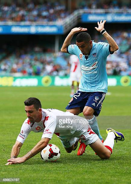 Ali Abbas of Sydney FC challenges Jason Hoffman of the Heart during the round 10 ALeague match between Sydney FC and the Melbourne Heart at Allianz...