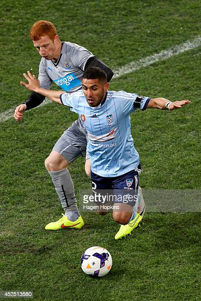 Ali Abbas of Sydney FC loses his footing in the tackle of Jack Colback of Newcastle United during the international friendly match between Newcastle...