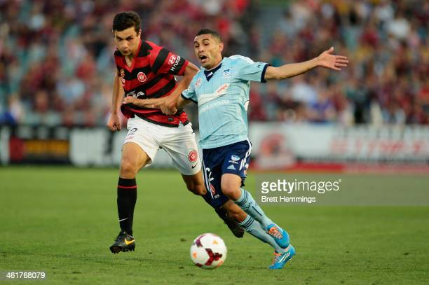 Ali Abbas of Sydney is tackled by Daniel Alessi of the Wanderers during the round 14 ALeague match between the Western Sydney Wanderers and Sydney FC...