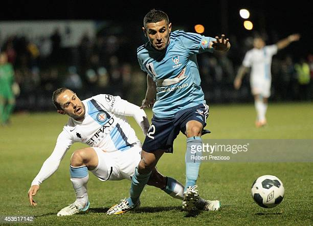 Ali Abbas of Sydney passes the ball during the FFA Cup match between Melbourne City and Sydney FC at Morshead Park Stadium on August 12 2014 in...