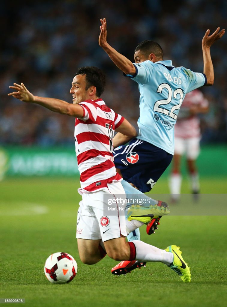 Ali Abbas of Sydney tackles Mark Bridge of the Wanderers during the round three A-League match between Sydney FC and the Western Sydney Wanderers at Allianz Stadium on October 26, 2013 in Sydney, Australia.