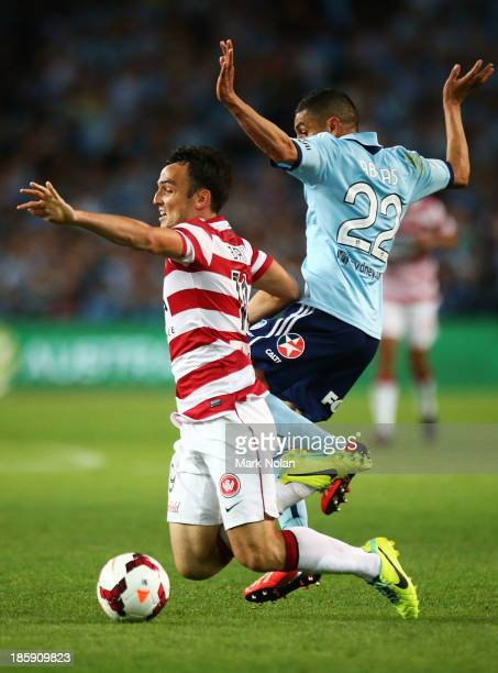 Ali Abbas of Sydney tackles Mark Bridge of the Wanderers during the round three ALeague match between Sydney FC and the Western Sydney Wanderers at...