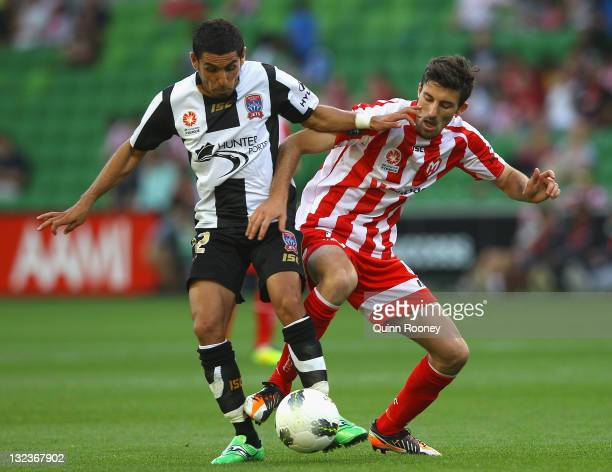 Ali Abbas of the Jets and Jason Hoffman of the Heart contest for the ball during the round six ALeague match between the Melbourne Heart and the...