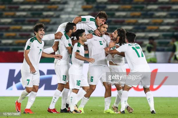 Ali Adnan Kadhim of Iraq celebrates his scoring with teammates by free kick during the AFC Asian Cup Group D match between Iraq and Vietnam at Zayed...