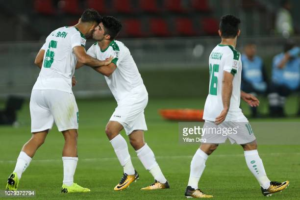 Ali Adnan Kadhim of Iraq celebrates with his teammate Alaa Ali Mhawi after scoreing the winning goal for Iraq during the AFC Asian Cup Group D match...