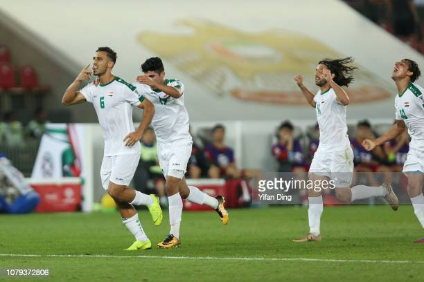 Ali Adnan Kadhim of Iraq celebrates with his teammates after scoring the winning goal for Iraq during the AFC Asian Cup Group D match between Iraq...