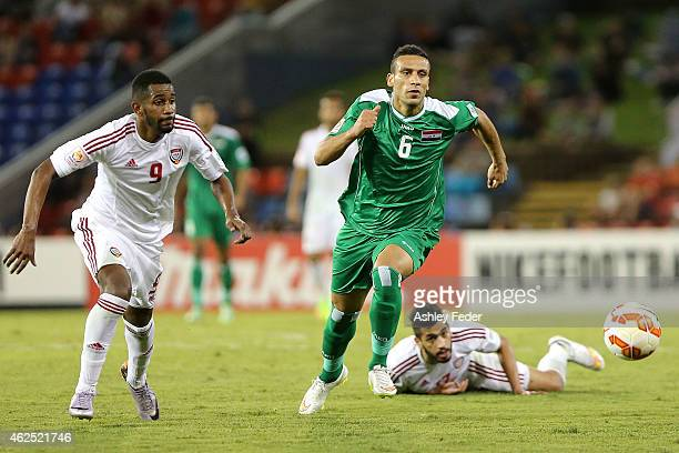 Ali Adnan Kadhim of Iraq controls the ball ahead of United Arab Emirates defence during the Third Place 2015 Asian Cup match between Iraq and the...