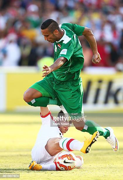 Ali Adnan Kadhim of Iraq is tackled during the 2015 Asian Cup match between Iran and Iraq at Canberra Stadium on January 23 2015 in Canberra Australia