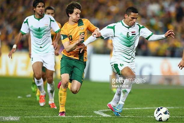 Ali Adnan Kadhim of Iraq runs the ball towards goal during the FIFA 2014 World Cup Asian Qualifier match between the Australian Socceroos and Iraq at...