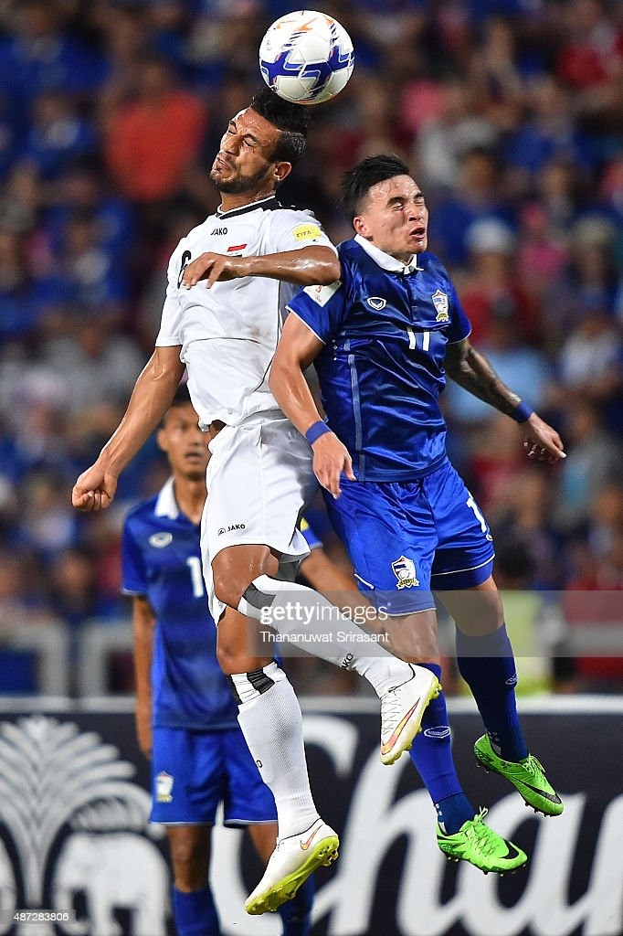 Ali Adnan #6 of Iraq (L) and Tristan Do #17 of Thailand 9R) competes for the ball during the 2018 FIFA World Cup Qualifier match between Thailand and Iraq at Rajamangala Stadium on September 8, 2015 in Bangkok, Thailand.
