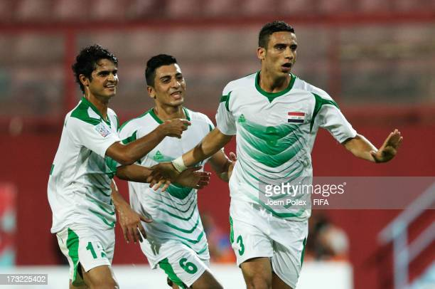 Ali Adnan of Iraq celebrates with his team mates after scoring his team's first goal during the FIFA U20 World Cup Semi Final match between Iraq and...