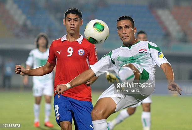 Ali Adnan of Iraq fight for the ball with Felipe Mora of Chile during a group stage football match between Iraq and Chile at the FIFA Under 20 World...