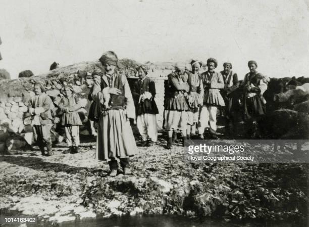 Ali Agha - a chief of the Mukuri Kurds and his followers at Newshehr village, Turkey, 1906.