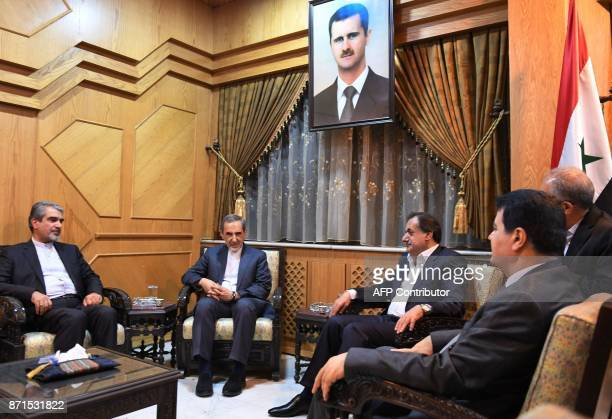 Ali Akbar Velayati chief foreign policy advisor to Iran's supreme leader attends a meeting with Syrian Ambassador to Iran Adnan Mahmoud Governor of...