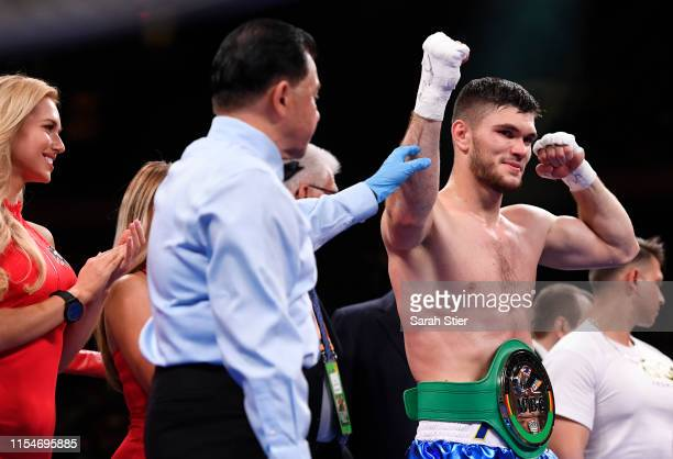 Ali Akhmedov of Kazakhstan poses with the championship belt after winning by technical knockout in the third round against Marcus McDaniel during...