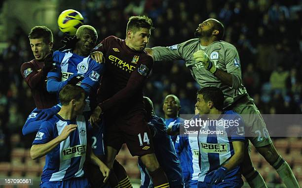 Ali Al Habsi and Jean Beausejour of Wigan battle with Javi Garcia and Matija Nastasic of Manchester City during the Barclays Premier League match...