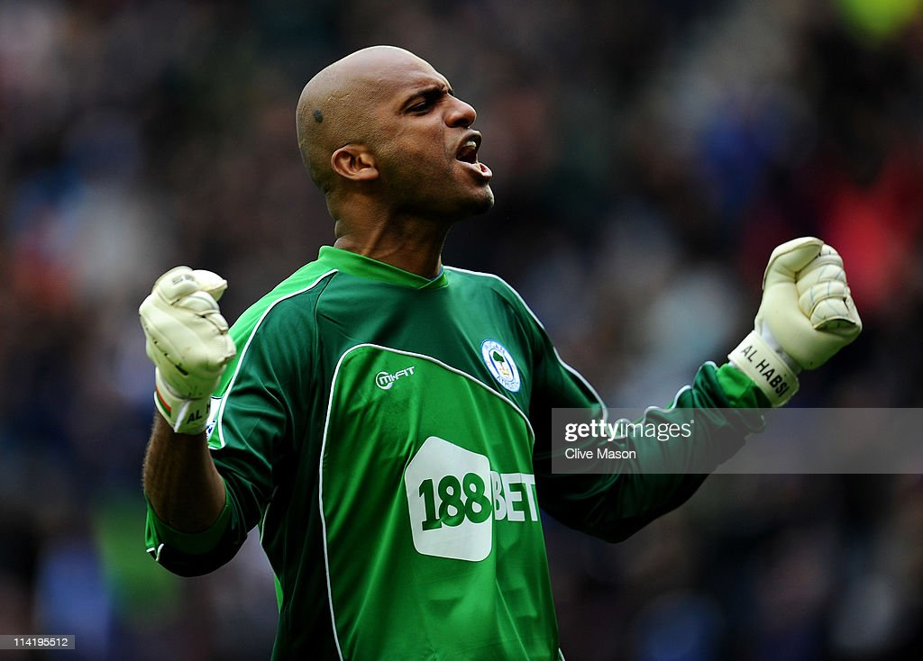 Ali Al Habsi of Wigan Athletic celebrates his team's second goal during the Barclays Premier League match between Wigan Athletic and West Ham United at the DW Stadium on May 15, 2011 in Wigan, England.