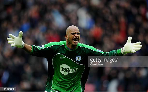Ali Al Habsi of Wigan Athletic celebrates his team's second goal during the Barclays Premier League match between Wigan Athletic and West Ham United...