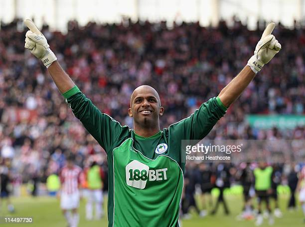 Ali Al Habsi of Wigan celebrates staying up during the Barclays Premier League match between Stoke City and Wigan Athletic at Britannia Stadium on...