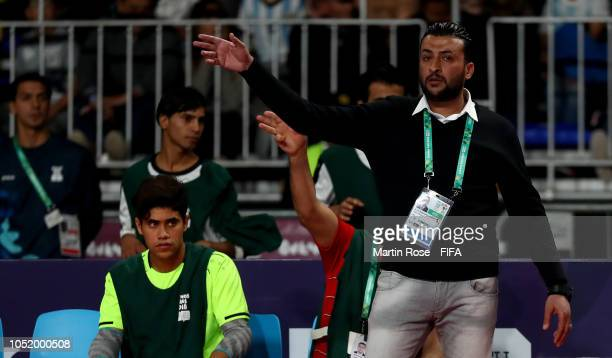 Ali Al Rubaeey head coach of Iraq celebrate gives instructions in the Men's Futsal Group A match between Argentina and Iraq during the Buenos Aires...