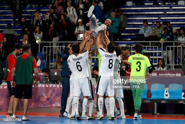 Ali Al Rubaeey head coach of Iraq celebrate with his team after the Men's Futsal Group A match between Argentina and Iraq during the Buenos Aires...