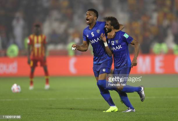 Ali Albulayhi and Yasser AlShahrani of Al Hilal SFC celebrates after their teammate Bafetimbi Gomis of Al Hilal SFC scored their team's first goal...