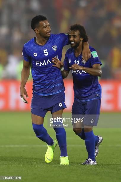 Ali Albulayhi and Yasser AlShahrani of Al Hilal SFC celebrates after their teammate Bafetimbi Gomis of Al Hilal SFC scored their team's first goal...