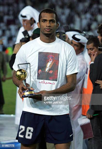 Ali alHabsi of Oman displays his best goalkeeper trophy after the final match of the 17th Gulf Cup tournament in Doha 24 December 2004 Qatar won the...