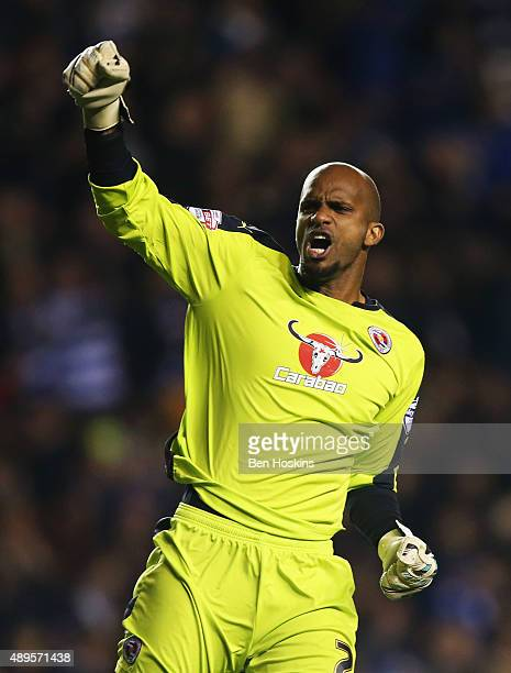Ali Al-Habsi of Reading celebrates after Nick Blackman of Reading scored the opening goal during the Capital One Cup third round match between...