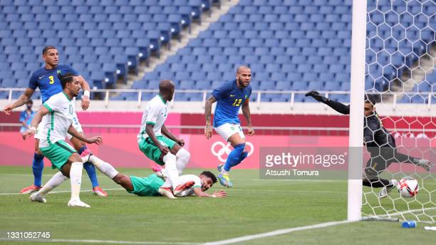 Ali Alhassan of Team Saudi Arabia scores their side's first goal past Santos of Team Brazil during the Men's First Round Group D match between Saudi...