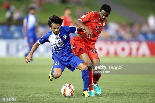 Ali Almaqseed of Kuwait contests the ball against Ahmed Mubarik of Oman during the 2015 Asian Cup match between Oman and Kuwait at Hunter Stadium on...