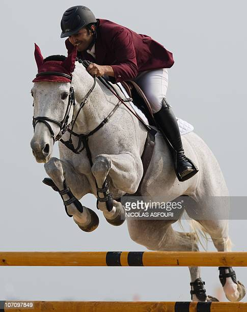 Ali alRumaihi of Qatar rides ambiente 55 during the equestrian jumping individual round A at the Guangzhou equestrian venue during the 16th Asian...